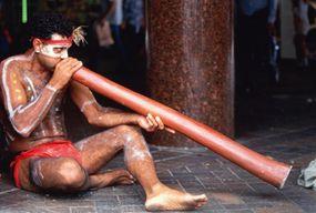Man playing a dijeridoo.