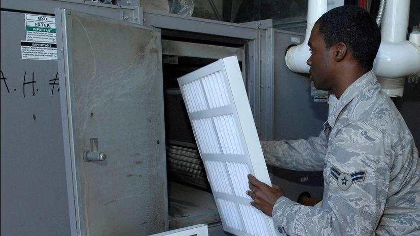 Airman replacing filter