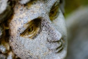 Acid rain can eat through stone and metal. It has accelerated the natural weathering process of this scarred stone angel's face.