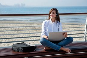 A good laptop and headset can help you turn a bench at the beach into your virtual workplace. Just don't get sand in your keyboard!