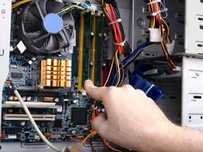 After safely opening up your desktop to reveal its insides, adding new RAM is a simple process.