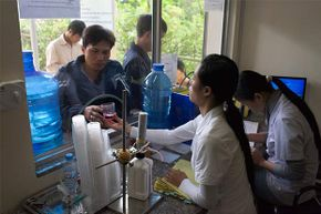 A nurse at the An Duong District Health Center of Hai Phong city, Vietnam prepares methadone for drug addicts.