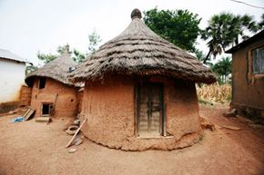 These adobe homes in Togo, West Africa are ideal for the area's dry climate. See more home construction pictures.