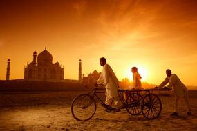 The Taj Mahal at sunrise is a stunning sight for an adventure tourist.