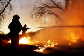 Firefighters battle the Woodhouse fire, also being called the Calimesa fire, in San Timoteo Canyon on Oct. 6, 2005, near Calimesa, California.