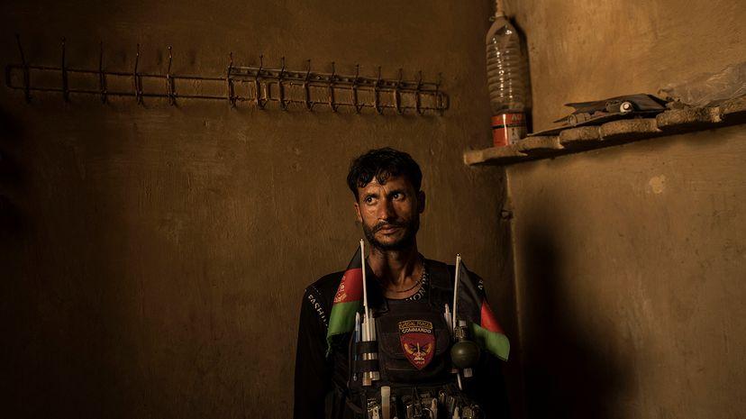Afghan soldier surveys a former ISIS-K jail