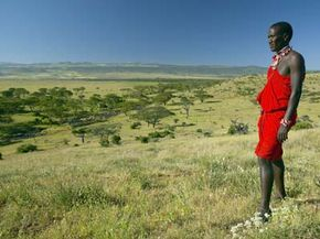 A Masai warrior surveys the landscape of the Lewa Wildlife Conservancy in Kenya, one of the oldest areas of human occupation.