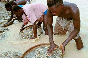 Workers pan for diamonds at a government-run mine in Sierra Leone. Al Qaeda is known to have made millions of dollars from the sale of diamonds mined illegally by the Revolutionary United Front (RUF) in Sierra Leone.