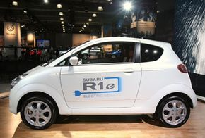 Image Gallery: Electric Cars The Subaru R1e electric car can be charged overnight on household current. It has a range of 50 miles and a top speed of 62 miles per hour. See more electric car pictures.