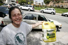 This bottle of used cooking oil was used to fill the gas tank of the converted 1984 Mercedes Benz 300 Turbo Diesel. See more alternative fuel vehicle pictures.