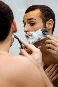Make sure your son uses a shaving cream or lotion when he begins shaving. See more pictures of personal hygiene practices.