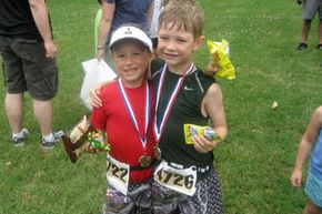 Triathlons for the pint-sized athlete? Of course! Chance Brawders and Breck Langan wear victorious smiles after the Vanderbilt Children's Triathlon in Nashville, Tenn.
