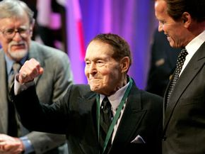 Jack LaLanne pumps his fist after being inducted into the California Hall of Fame, Dec. 15, 2008. California Governor Arnold Schwarzenegger is to his right. See more pictures of healthy aging.