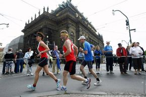 Runners amble by the historical center of Prague, Czech Republic, during the Prague International Marathon in May 2010.