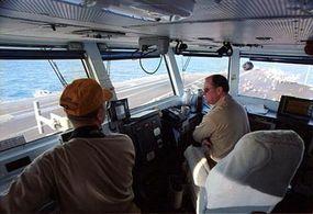 Captain David Logsdon commands the USS Harry Truman from the flight deck.