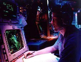 An antisubmarine warfare specialist on the USS Carl Vinson monitors activities in the Persian Gulf.