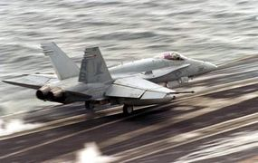 An F/A-18 Hornet launching from the USS George Washington