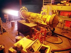 Testing an F-14 engine on the fantail of the USS Kitty Hawk