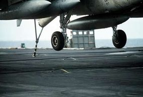 The tailhook of a KA-6D Intruder aircraft, about to catch an arresting wire on the USS Dwight D. Eisenhower