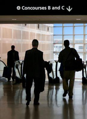 Travelers rush through the airport.