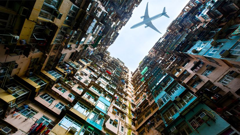 An airplane flies over a high-rise apartment building in Hong Kong. Patrick Foto/Getty Images