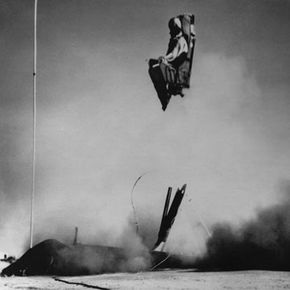 A 1958 U.S. Navy ejection seat hurls a dummy into the air.