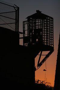 An empty guard house near the prison recreation yard as the sun sets on Alcatraz