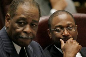 Two Chicago Aldermen -- William Beavers, at left, and Todd Stroger -- listen at a meeting on June 28, 2006.