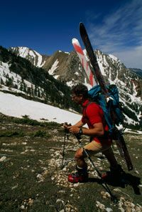 At lower elevations, you'll probably be wearing your ski boots and carrying your skis up the mountain.