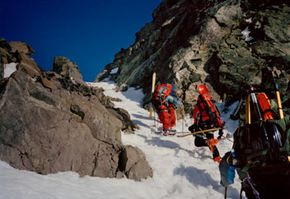 A group of alpine tourists on the ascent in Norway