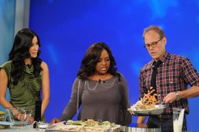 """Alton Brown, right, as a guest cook on """"The View"""" in 2009."""