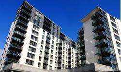 Real estate investment groups contribute money to companies that purchases large properties like condos developments.