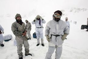Pakistani Army soldiers walk above their military outpost at the Siachen Glacier -- 18,655 feet (5,686.04 meters) above sea level. Soldiers generally spend 90 days at a high altitude base before descending.