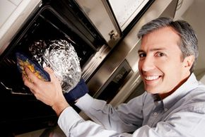 This man may be smiling as he puts the aluminum foil in the microwave, but he won't be smiling for long.