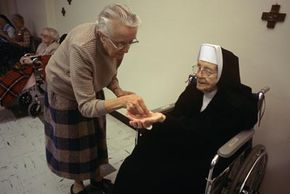 Elderly Sister of Notre Dame receiving her medicine. The Sisters of Notre Dame have been studied for years by Dr. David Snowson and others at the Sander-Brown Center for Aging at the University of Kentucky.