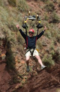Lynn Warren, an executive assistant from West Hollywood, Calif., travels over a gorge in Huambutio, Peru