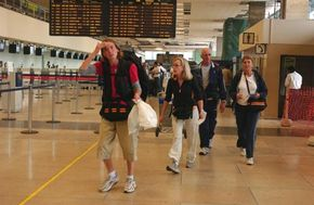 Teammates Susan and Patrick and Gretchen and Meredith navigate their way through the airport in Arequipa, Peru