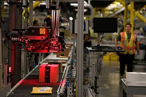 Packages move through a labeling machine at the 1.2-million-square-foot Amazon fulfillment Center in Tracy, California.