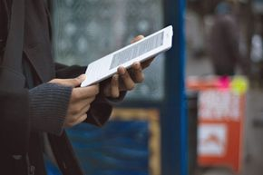 Once a rare sight on city streets, the Kindle is now a common accessory for the daily commute.
