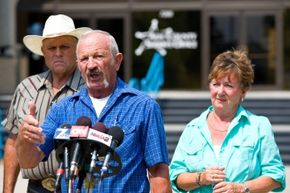 Mark John, Mike Young and Mary Young, shown here at a press conference on Aug. 11, 2013 saw an Amber alert about missing teen Hannah Anderson and reported that they had spotted Anderson and her abductor at a campground.