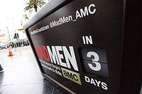 A sign heralds the final season of 'Mad Men' on AMC. Note the hashtag and Twitter handle at the top of the billboard.
