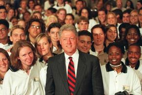 Former President Bill Clinton meets with graduates of AmeriCorps on Aug. 9, 1999.