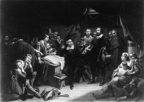 William Bradford, long-time governor of Plymouth Colony (seated) reads the Mayflower Compact.
