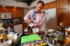 """Author and host of """"America's Test Kitchen,"""" Chris Kimball, serving up corn soup in 2004."""