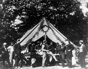Amputations were common during the American Civil War. The limbs were often tossed onto large piles just outside of surgical tents like this one in Gettysburg, Pennsylvania, 1863.