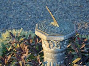 Though innocently situated in a peaceful garden, sundials can be much more deviously complex than they first let on.