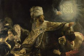 The writing was literally on the wall for King Belshazzar in this painting by Rembrandt.