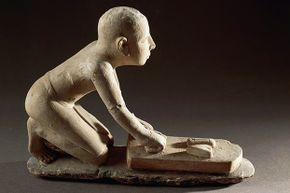 This Egyptian figurine from around 3500 B.C.E. shows a baker at work.