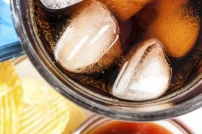 Crunching on the ice from your soda isn't a cause for concern, but if you compulsively eat large quantities of ice, it could be a symptom of a medical issue.