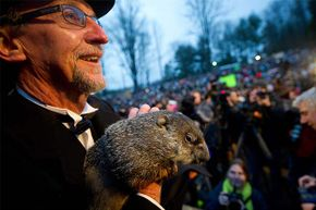 Groundhog handler Ron Ploucha holds Punxsutawney Phil after he saw his shadow predicting six more weeks of winter during the 126th annual Groundhog Day festivities on Feb. 2, 2012 in Punxsutawney, Pennsylvania. Phil was right that year, for a change.